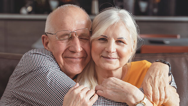 cheerful senior couple smiling